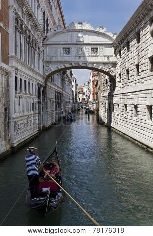 Gondolier floating in the Bridge of Sighs Canal