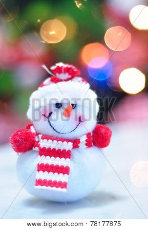 Snowman And De-focused Christmas Light Background