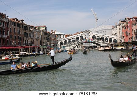 People Sailing With Rialto Bridge on the Background