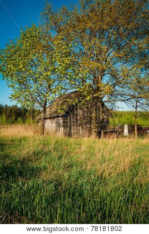 Russian Antique Wooden Village House In Russia In Summer, Spring Sunny Day. Rural Landscape With Old