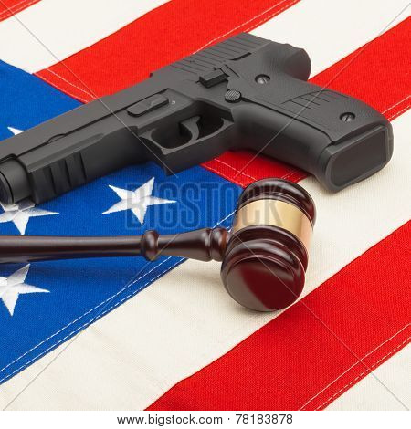 Wooden Judge Gavel And Gun Over Usa Flag - Studio Shoot