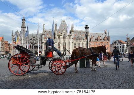 Horse Carriage On The Market Square In Bruges, Belgium