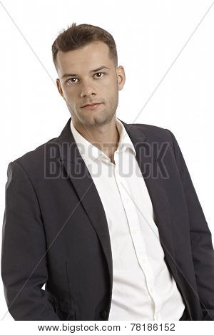 Portrait of serious young businessman in jacket and shirt.