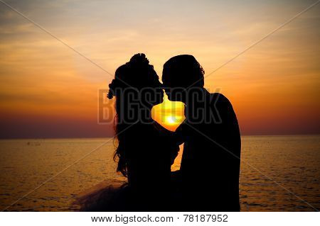 Love Couple Kissing Silhouette At Sunset.
