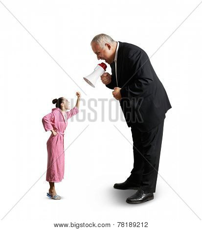 emotional senior man in suit holding megaphone and screaming at angry woman in pink dressing gown. isolated on white background