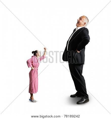 angry woman screaming and showing fist laughing senior man. isolated on white background
