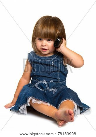Cute Little Baby Is Talking On Cell Phone, Isolated Over White