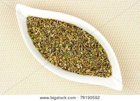 Dried And Chopped Oregano In Stylish Glass Container