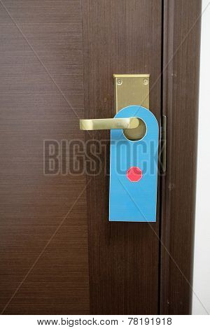 image of a Do not disturb sign hang on door knob