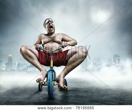 Nerdy man riding a small bicycle