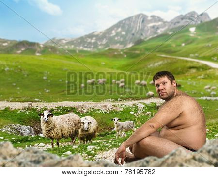 Srange naked man sits in mountains