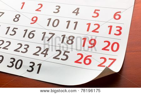 Page from calendar lies on the table