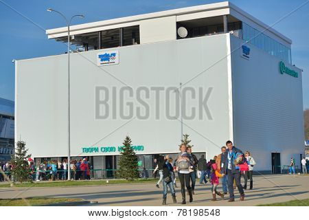 SOCHI, RUSSIA - FEBRUARY 12, 2014: People near the pavilion of the mobile operator Megafon in the Olympic park during Winter Olympics. Russia hosted the second Olympics in history
