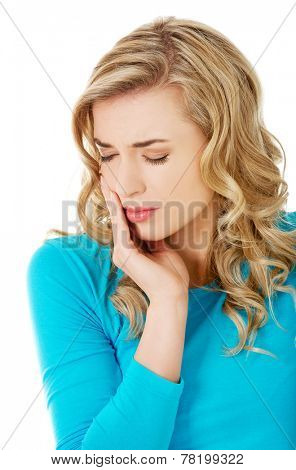 Portrait of woman having strong toothache.
