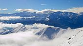 picture of italian alps  - Aerial view of the alpine arc in a winter scenery with foggy valleys below - JPG