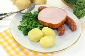 image of peeing  - a white plate with kale smoked meat and pee sausage - JPG