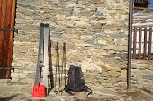 image of avalanche  - Pair of tour ski with backpack and light shovel for avalanche rescue on old stone wall of alpine hut in the italian Alps - JPG