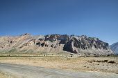 foto of manali-leh road  - Road near Canyon and Mountains in Indian Himalayas - JPG