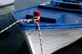 foto of old boat  - Old blue and white boat on a dock - JPG