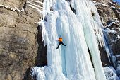 pic of mountain-high  - Man climbing frozen waterfall - JPG