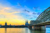 stock photo of koln  - Cityscape of Cologne from the Rhine river at sunset - JPG