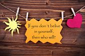 stock photo of philosophy  - Orange Tag Or Label With Sun And Heart On A Line With Life Quote If You Dont Believe In Yourself Then Who Will On Wooden Background Two Symbols Vintage Retro And Old Fashion Style With Frame - JPG