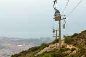 image of ropeway  - View of cableway located at Benalmadena Andalusia Spain on a hot summer day - JPG