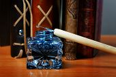 picture of inkwells  - Inkwell and pen against standing leather organizers - JPG