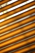 picture of jalousie  - Daylight through brown metal jalousie in closeup - JPG
