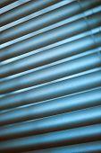 image of jalousie  - Metal jalousie background in blue toning in closeup - JPG