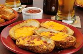 image of bacon  - Potato skins with cheese and bacon bits on a bar counter - JPG