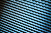 picture of jalousie  - Metal jalousie background in blue toning in closeup - JPG