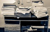 picture of messy  - Messy workplace with stack of old paper - JPG