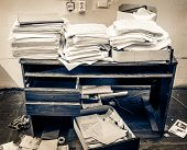 pic of messy  - Messy workplace with stack of old paper - JPG