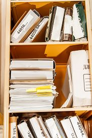 foto of stelles  - Stell office bookcase with stack of paper - JPG