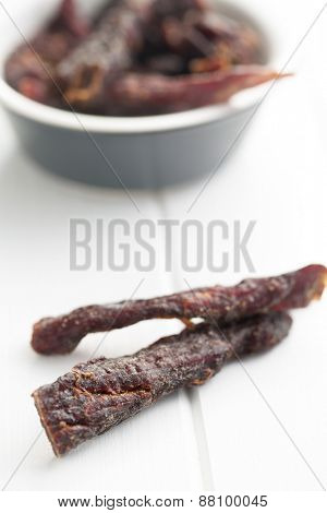 spice beef jerky on white table