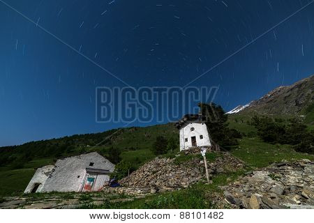 Old Alpine Rural Settlement With Startrail