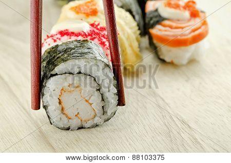 Sushi Roll In Chopsticks