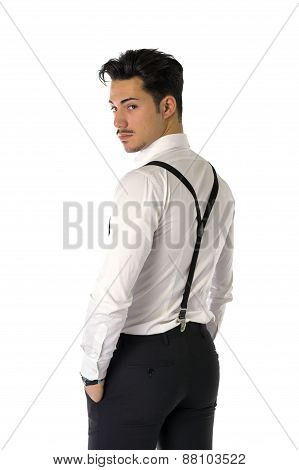 Handsome elegant young man with business suit, suspenders