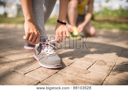 Lacing up sneakers