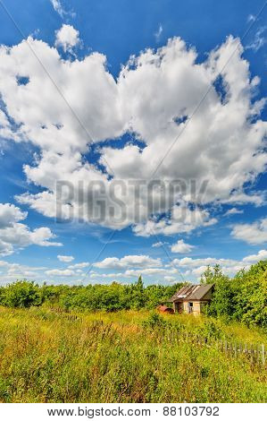 Abandoned Hut Beneath Cloudy Sky