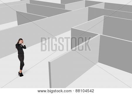Beautiful businesswonan think against maze