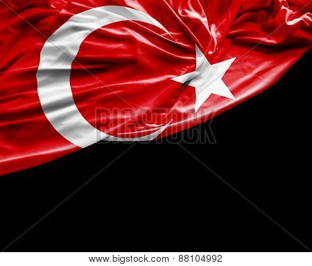 Turkish waving flag on black background