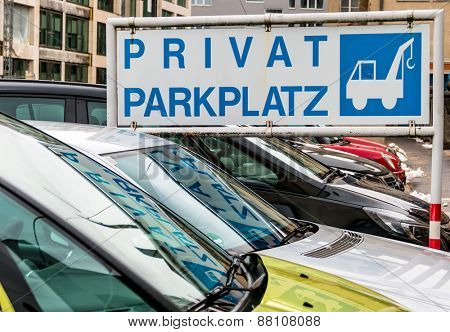shield private towing, symbol for parking, towing, costs