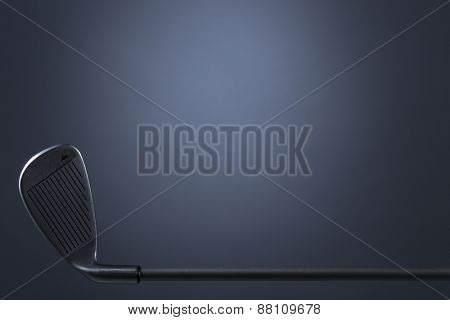 Golf club isolated on dark blue background, empty copy space for text.