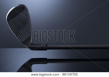 Golf club isolated on dark blue background with reflection, blank copy space for text.