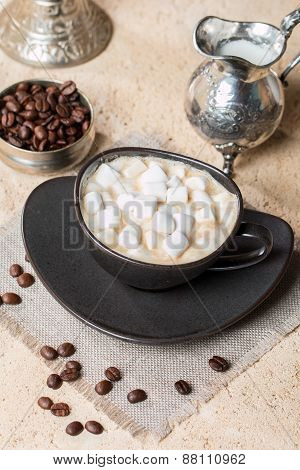 Cup Of Coffee With Marshmallow, Milk Jug And Coffee Beans