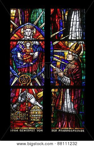 VIENNA, AUSTRIA - OCTOBER 11: Stained glass that shows pilgrimage to Mariazell, Votiv Kirche (The Votive Church). It is a neo-Gothic church in Vienna, Austria on October 11, 2014