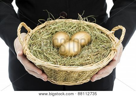 Businesswoman Holding Basket Full Of Golden Eggs