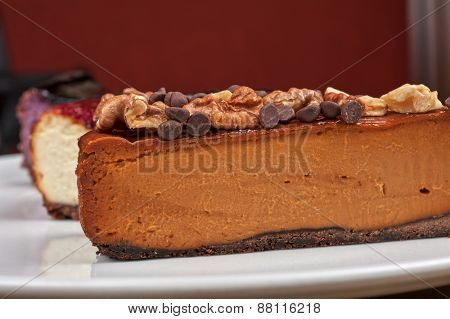 slice of cheesecake with chocolate and nuts